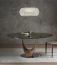Tavolo da pranzo rotondo con pian in vetro. Tavolo design made in italy. Vendita online di mobili di lusso.
