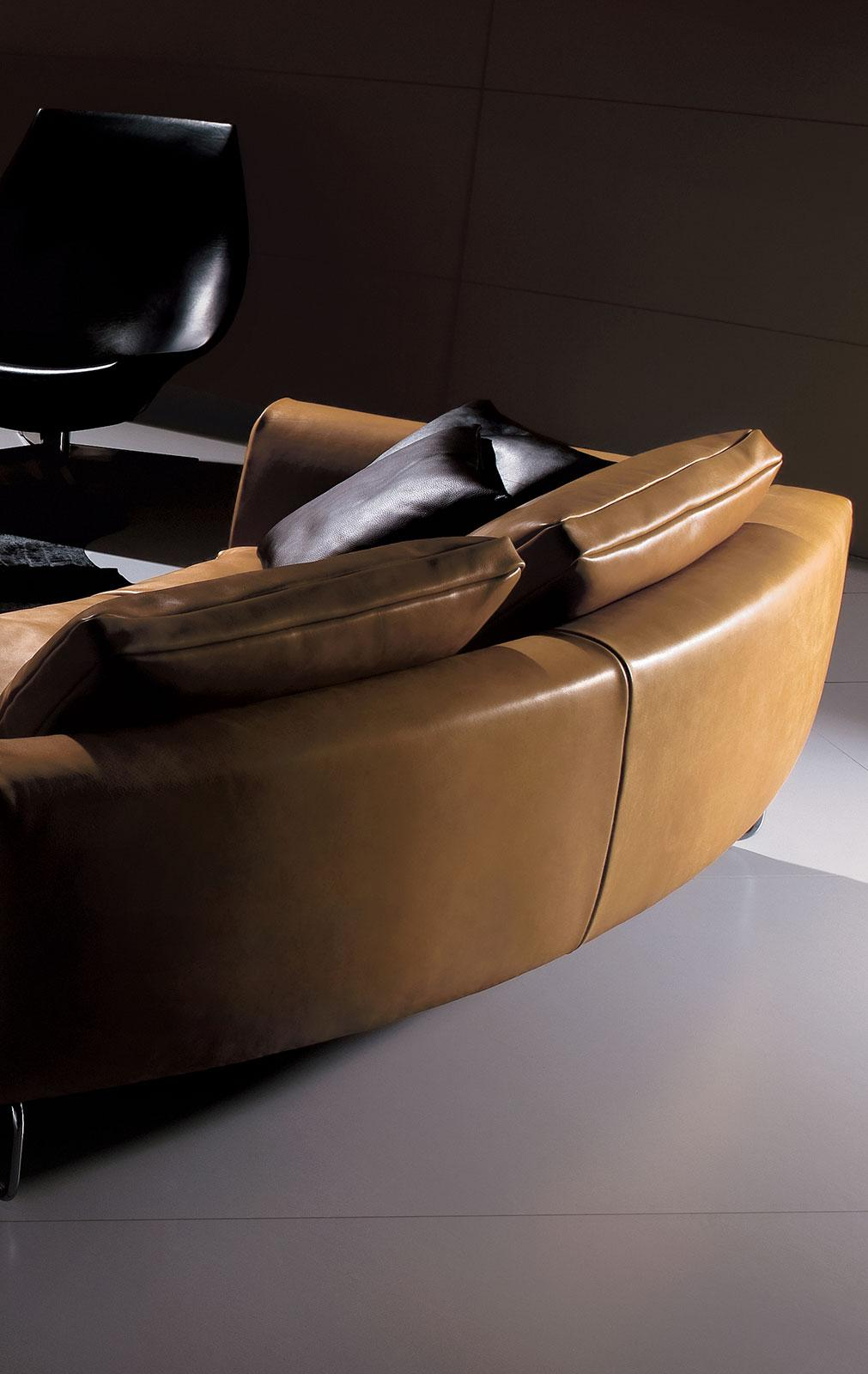 Add-Look Round is a luxurious sofa designed by Mauro Lipparini. This round leather sofa with solid wood frame, goose feathers padding and leather covering is perfect for any room.