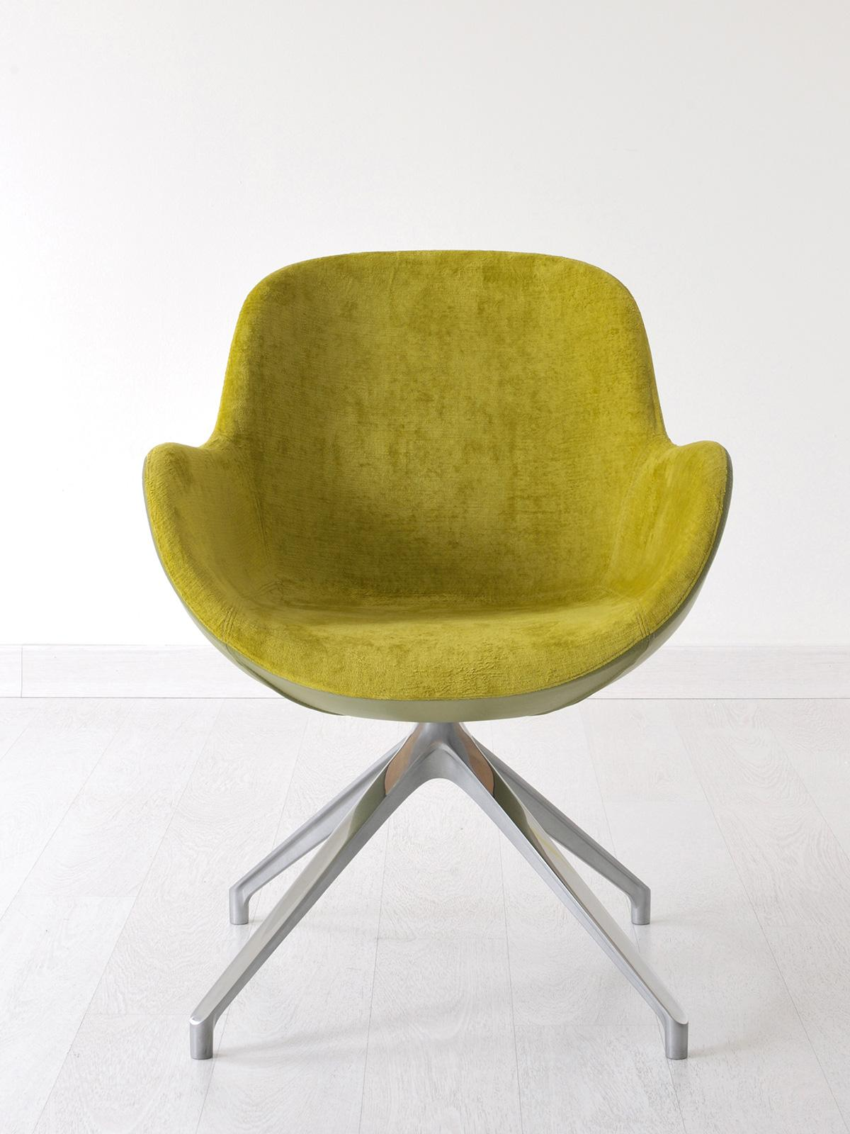 Swivel armchair with shell shape. Matching velvet and leather for luxurious covering. Metal 4-feet base. Design by Edi & Paolo Ciani. Free shipment.