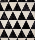 Barby Rock is a rectangular modern rug born by recoloured Turkish kilims and leathers. Triangles pattern. Online Shopping and free home delivery.
