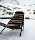 Stainless steel frame, gloss black finish. The deckchair in eco-leather (chinchilla or grey fox) is suitable for outdoor use in the most luxurious chalets.