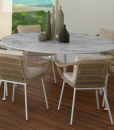 Precious Calacatta white marble and die-cast aluminium feet. A luxurious outdoor round table designed by L+R Palomba. Shop online. Free home delivery.