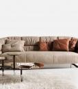 Canapé en cuir assymétrique avec sangles en cuir. Vente en ligne de canapés design haut de gamme made in italy avec livraison gratuite.