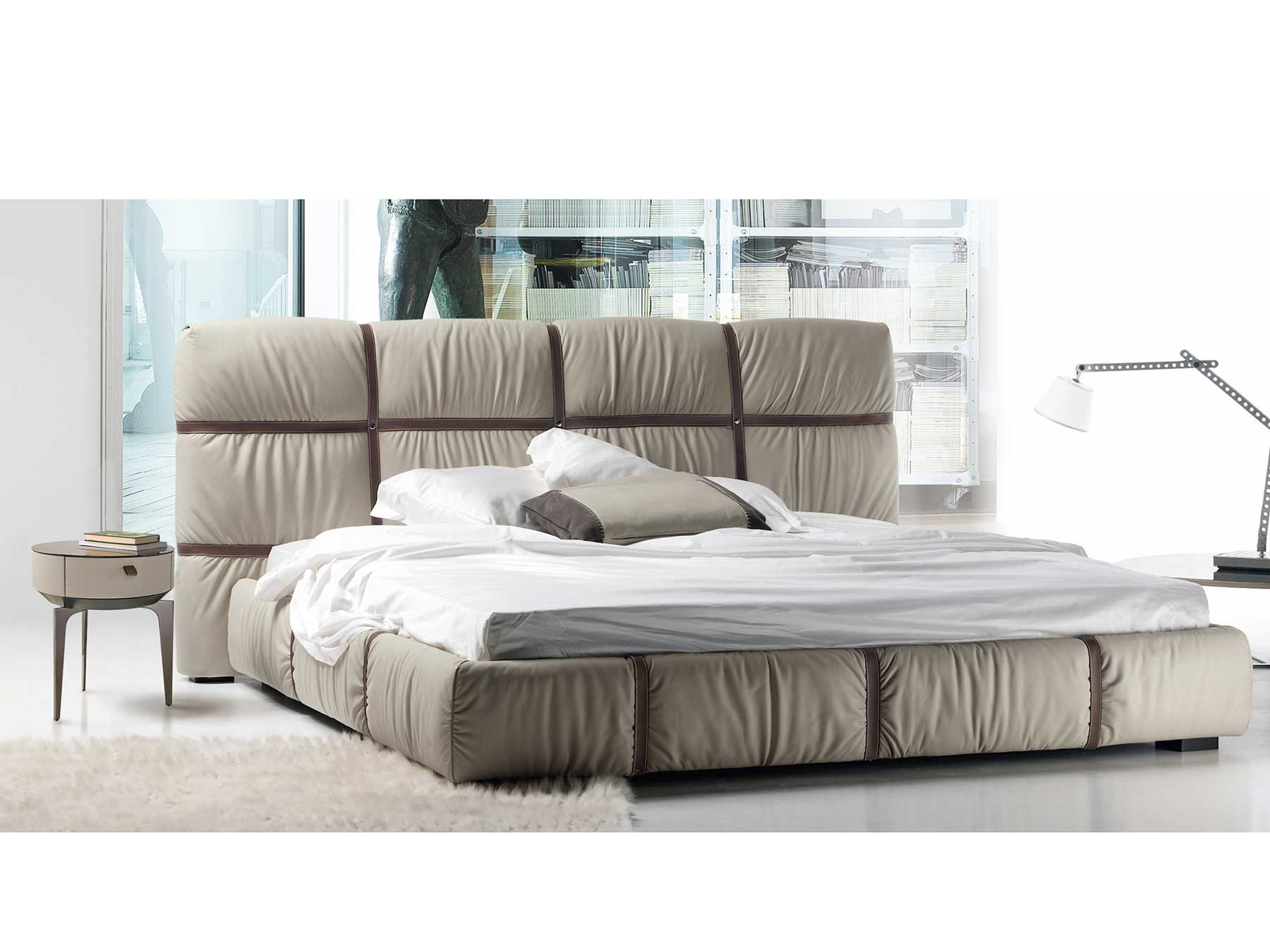 Welcoming and warm shapes and volumes. Crossover leather bed with bends will furnish the bedroom of your luxurious home. Online shopping. Free home delivery
