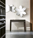 "Buy online the beautiful and playful mirror flower ""FIORE"" designed by Elena Viganò. 6 mobile petals. 100% made in Italy furniture complement. Home delivery"