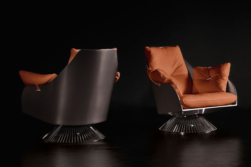 Gloss orange swivel armchair by Giuseppe Viganò in hardwood frame and seat and backrest high-quality leather cushions. Free shipping made in Italy furniture