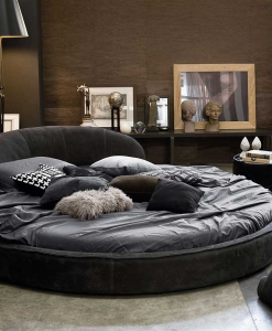 An extraordinary round bed to furnish the most elegant bedrooms. Leather covered. Wood frame. Many colours available. Online shopping, free delivery.