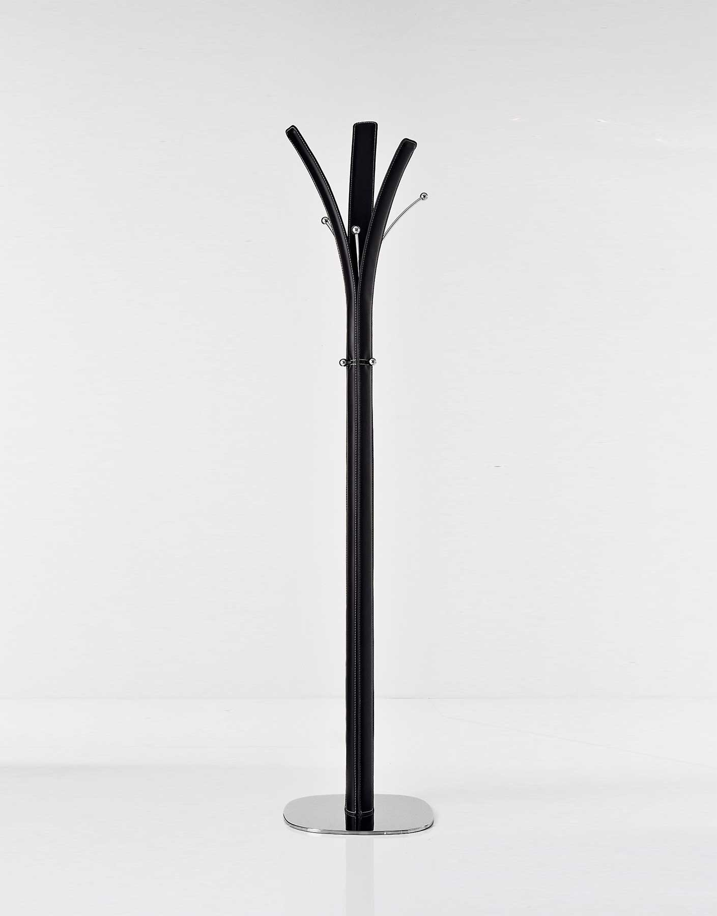 Refined clothes stand designed by Arter and Citton. Covered with regenerated leather. Metal frame, chromed details. Home delivery, online shopping.