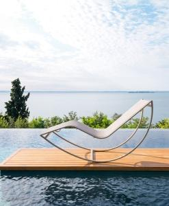 luxury outdoor rocking lounger sunbed chair outdoor pool side garden terrace hotel aluminium karim rashid luxury furniture