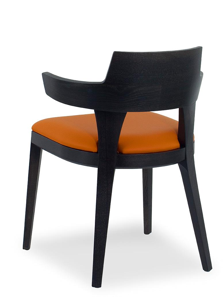 Padded chair in wood with armrests. Covering in velvet or in soft leather. Many colours available. Online shopping and home delivery. Made in Italy.