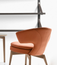 Larissa armchair in orange leather and walnut base