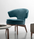 Larissa small armchair in petrol blue leather has a walnut base and can be shipped for free. Ideal for use at home or in a luxurious office. Online shopping