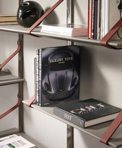 Libreria murale in pelle con mensole in cemento. Scrittoio incorporato. vendita online di mobili di lusso made in italy per la casa ed il giardino.
