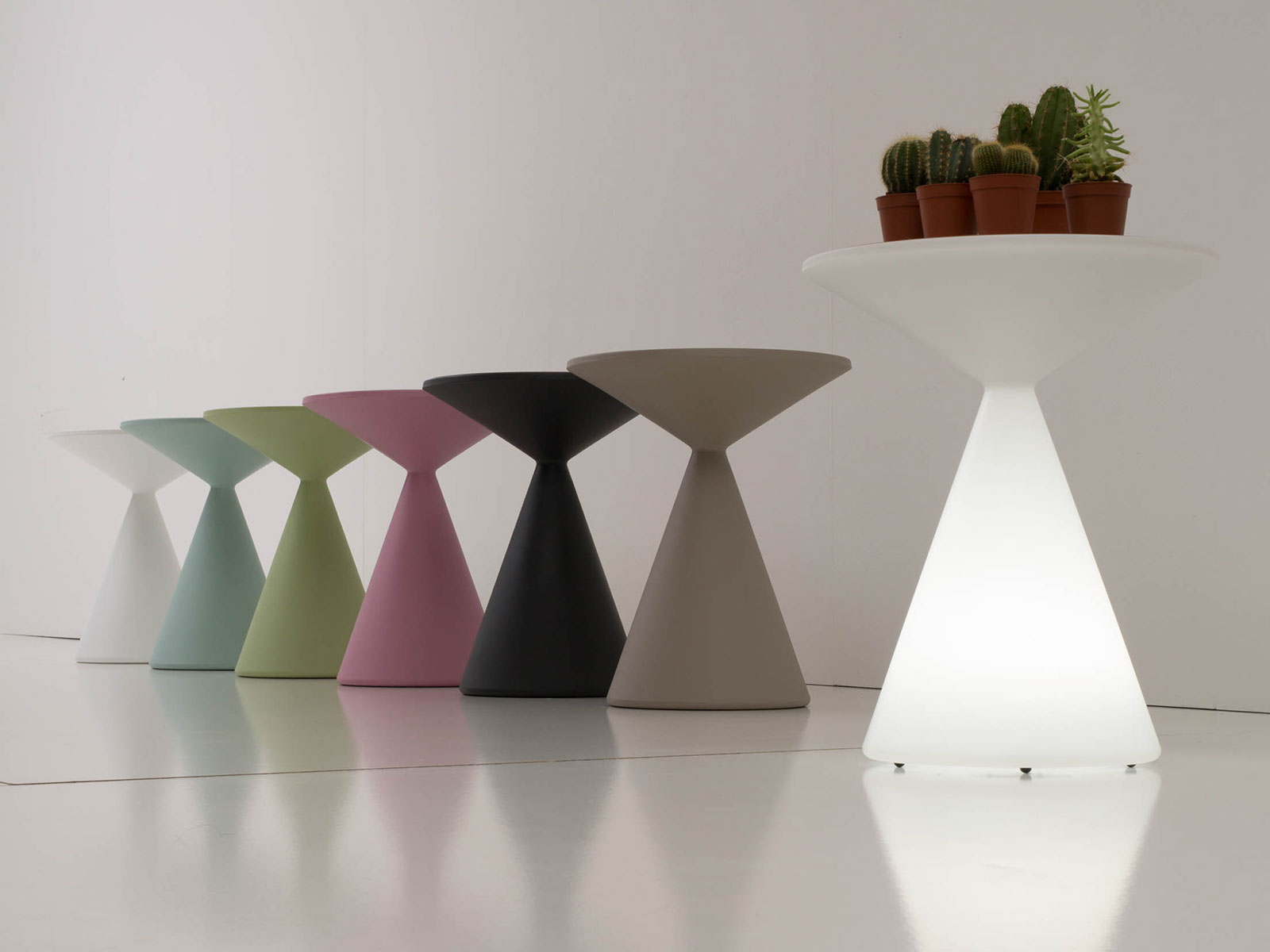 Lucy is a built-in LED round coffee table suitable for outdoor use. Andrea Lucatello design, polyurethane, RGB light and remote control, removable top.