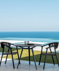 Margot is a small and solid round outdoor table designed by Marco Acerbis. White or grey colours at choice, diameter cm. 90. Online shopping.