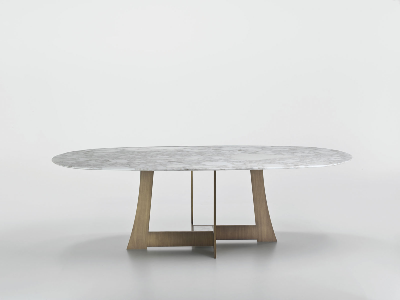 Oval design dining table made in italy. Marble table designed by Umberto Asnago. Buy online our luxury Italian furniture for home, office, garden.