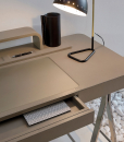 Luxurious writing desk leather covered. You can also use it as toiletry desk. Wood, saddle leather, steel and glass, as well as Umberto Asnago design.
