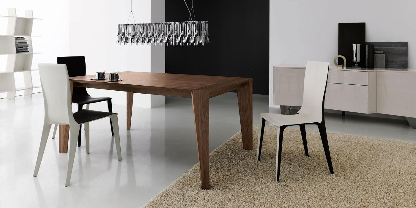 Pulse is an extendable wood dining table designed by Arter & Citton. The graceful curves and designs of this modern dining table are created to add elegance to any room.
