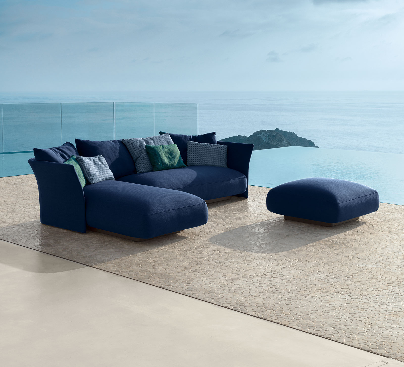 Ludovica and Roberto Palomba designed a wonderful outdoor lounge set. Sofa, chaise longue and pouf padded and covered with removable fabric. Free delivery.