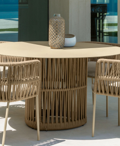 The designers Ludovica and Roberto Palombo created a refined and luxurious outdoor round table with aluminium frame and synthetic fabric ropes weaving.