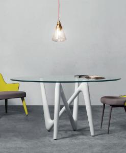 Tavolo da pranzo rotondo con piano in vetro e gambe intrecciate in metallo veniciato. Vendita online di mobili di lusso made in italy. Trasporto offerto.