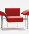 Relax invitation from a Paolo Benevelli furniture icon. Spelt armchair and footrest are covered in wonderful bright red leather. Steel frame. All removable.