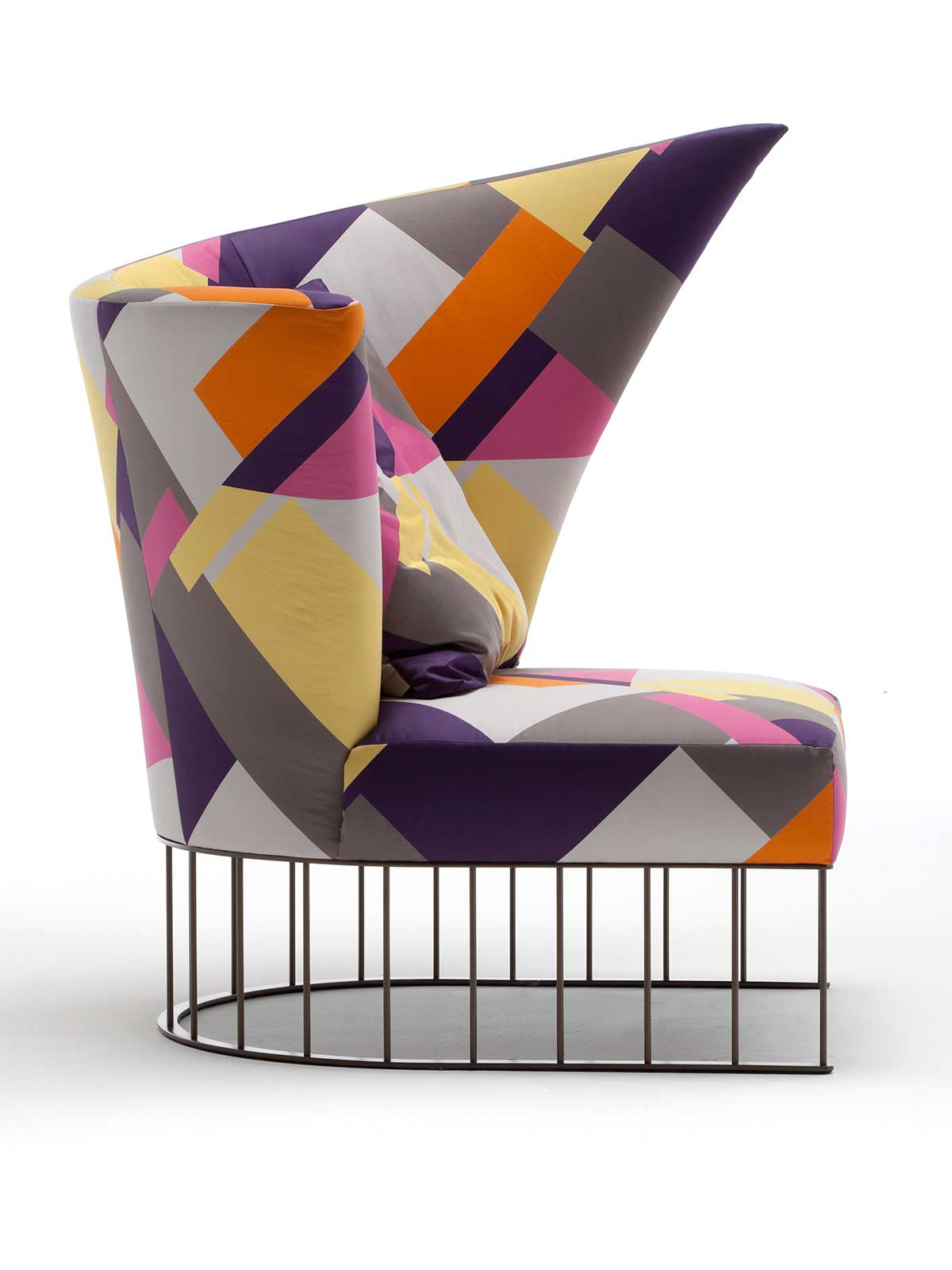 A curved shape luxurious armchair with patterned fabric and chrome steel base. A very suggestive high-quality piece of furniture. Free delivery.