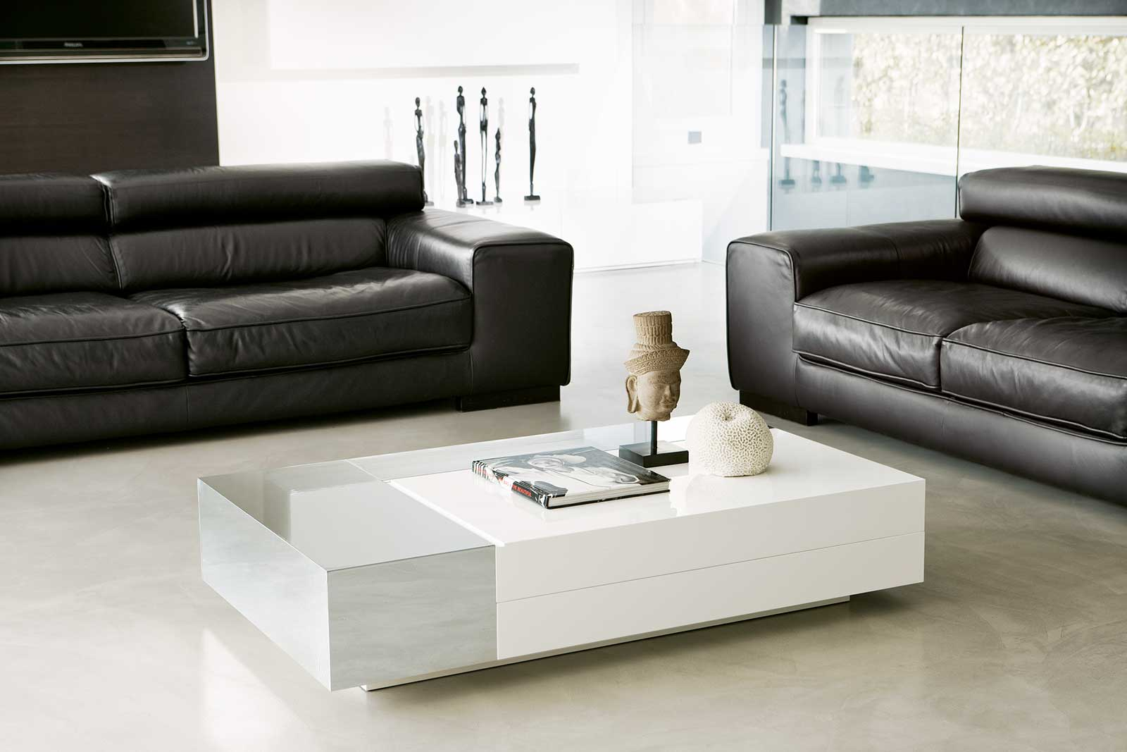 Ambrogio Sala designs a luxurious rectangular coffee table. Lacquered wood fibre. The sliding top hides a storage compartment. Free home delivery.