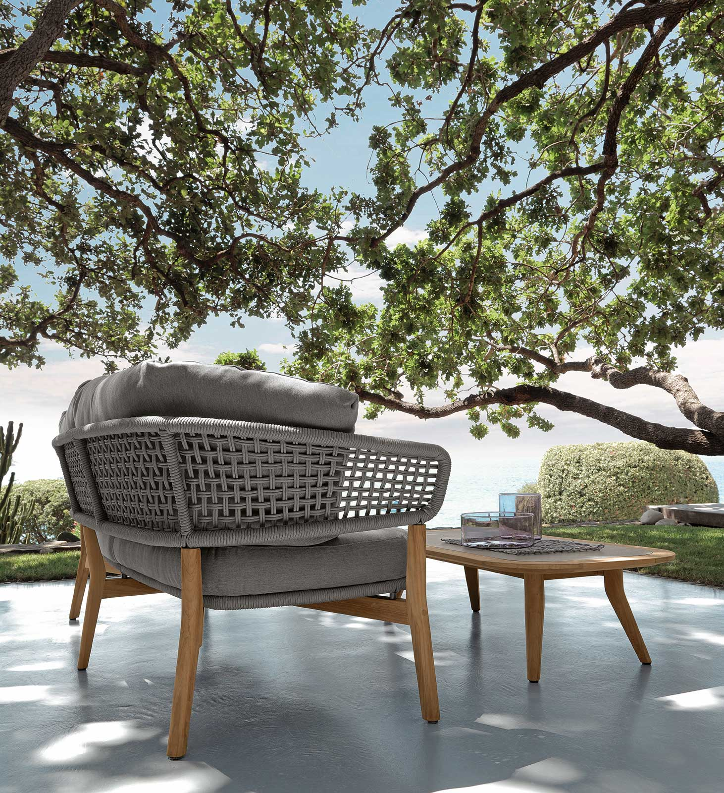 Luxurious outdoor lounge set in aluminium and teak signed by Cristian Visentin. Garden sofa, armchairs and coffee table. Shop online, free shipping.