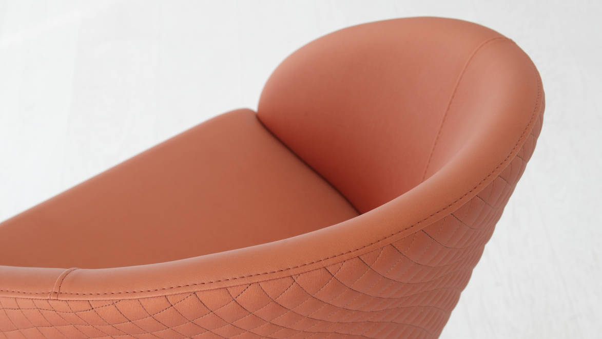 High-quality synthetic fabric to cover a beautiful and modern padded quilted armchair following your needs. Online shopping and home delivery.