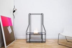 Wall Street Journal bio ethanol fireplace Giulio Iacchetti handcrafted made in Italy steel concrete cement white Carrara marble